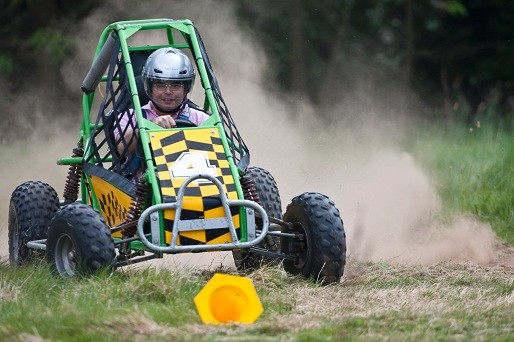 Racing a buggy in a field